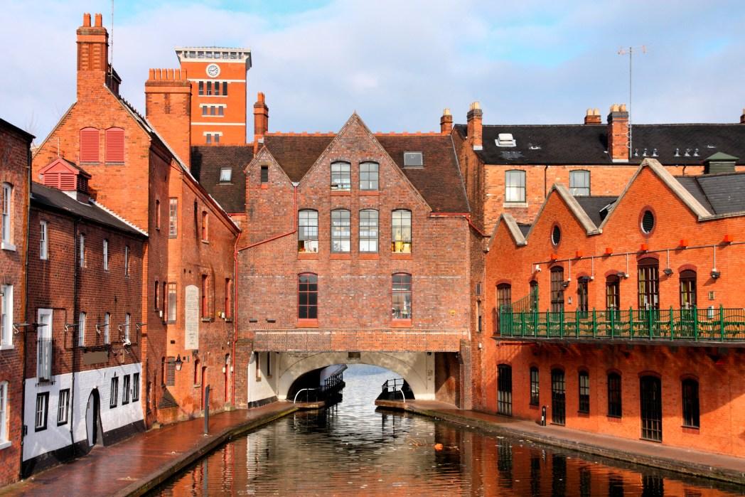 Houses made of bricks surround a river