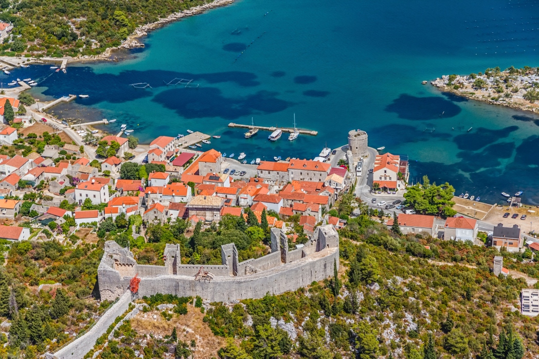 Charming town surrounded by greenery and the sea