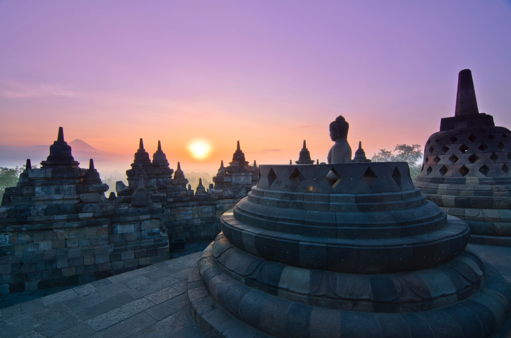 Sunrise with buddhist temple in foreground