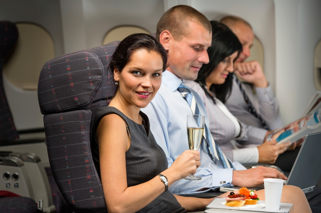 Woman drinking champagne on a flight.