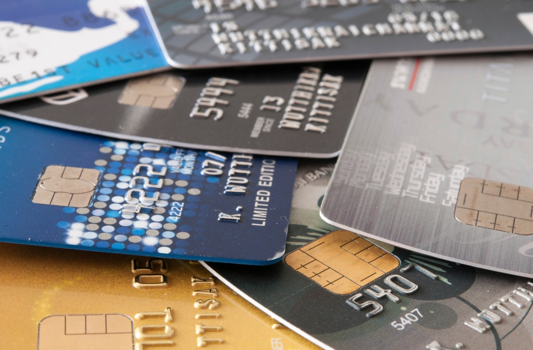 Stack of credit cards spread across a table.