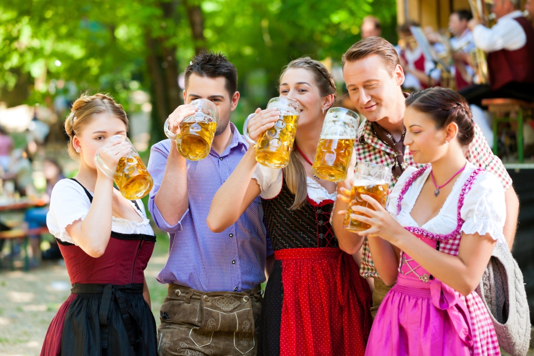 A few people drinking beer at Oktoberfest October travel