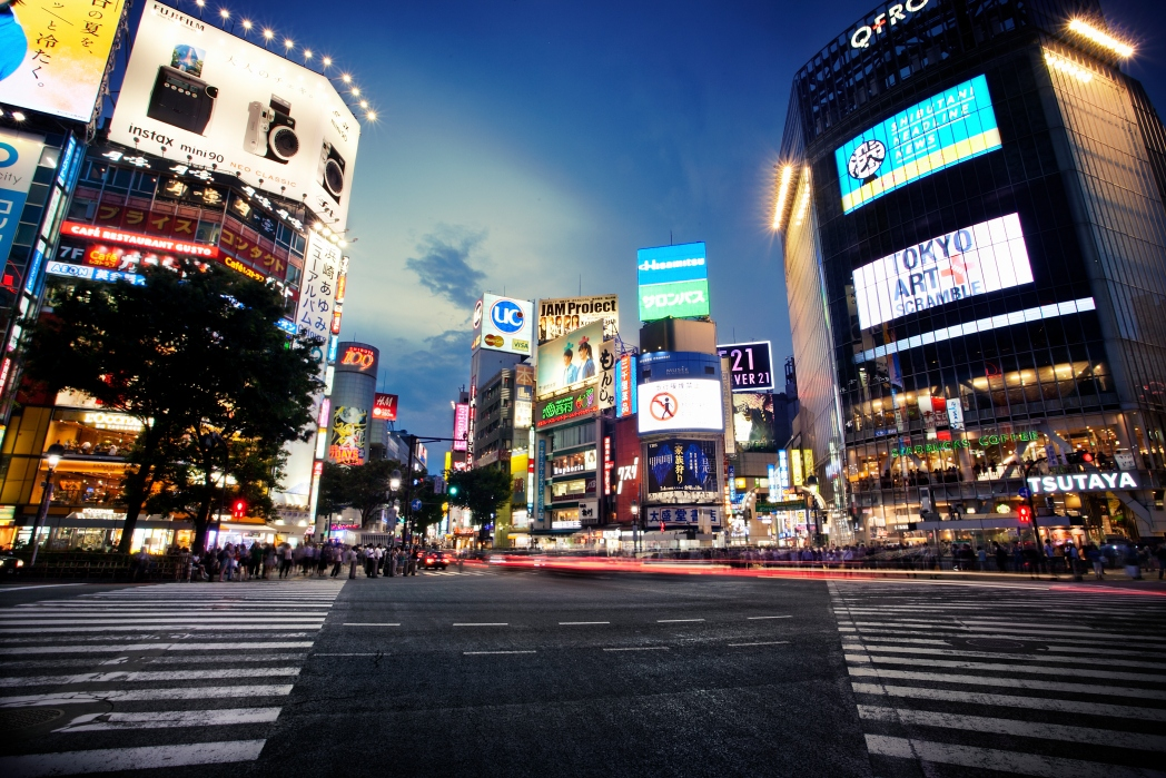 Shibuya crossing with neon lights on buildings October travel