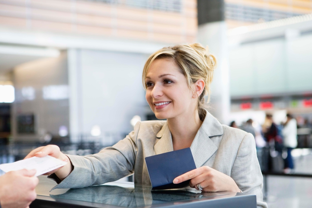 Female passenger checking in at the flight counter.