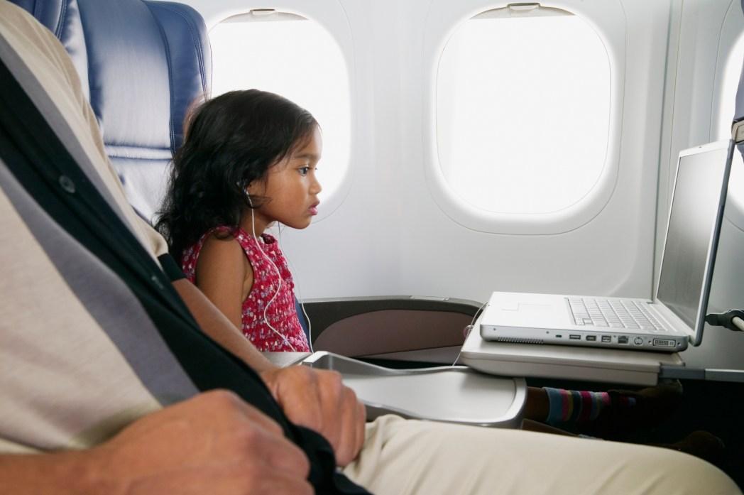 Young girl watching laptop screen