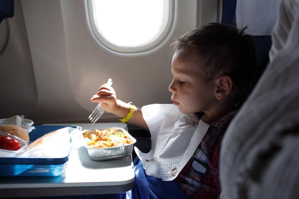 Child eating on plane