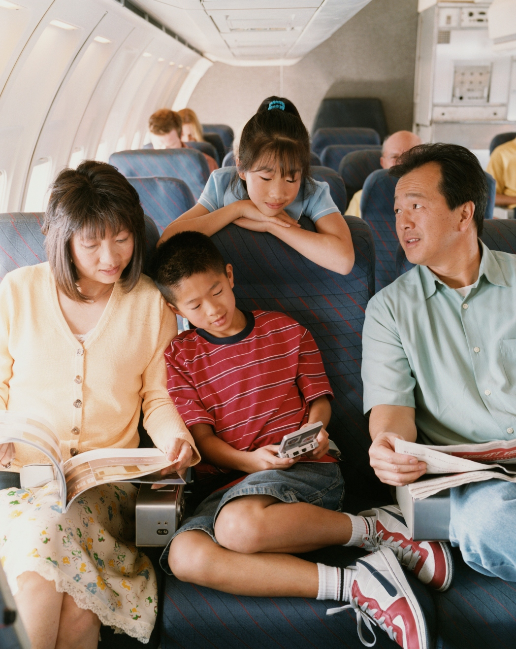 Family of four on a plane
