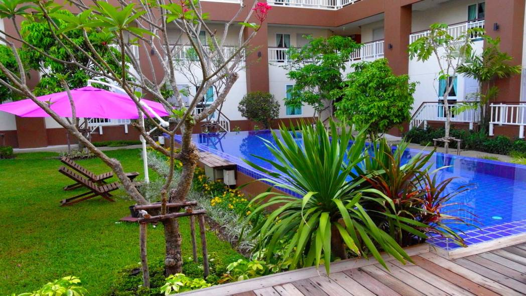 Image of hotel pool and tropical garden
