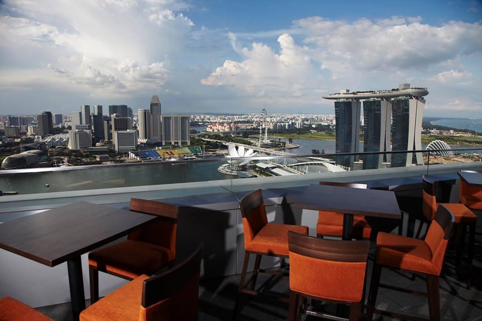 Sky-high bar terrace with panoramic views of Marina Bay.
