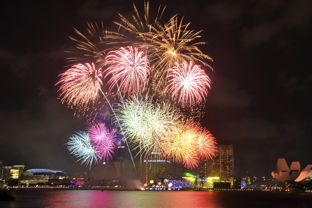Watch fireworks at the Marina Bay Promontory with a picnic basket and a group of friends