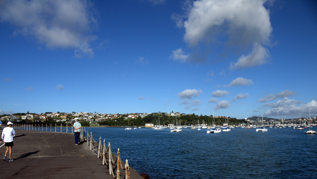At the pier, overlooking the seas at Mission Bay dotted by white sail boats.