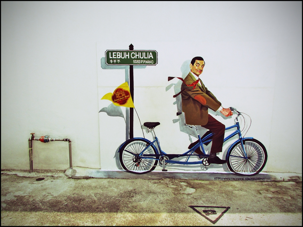 Painted Mr. Bean on the wall riding a bicycle