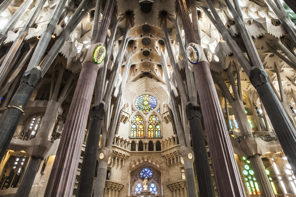 Inside La Sagrada Família, features elegant arches and intricate patterns