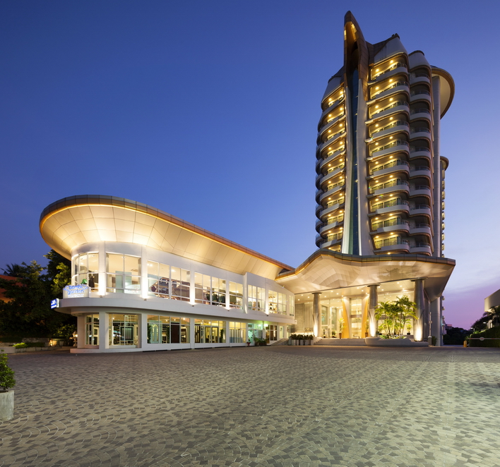 Image of exterior of new hotel with night sky in background