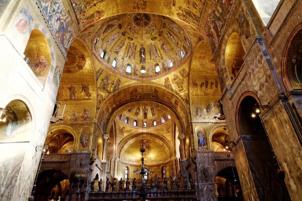 Saint Mark's Basilica interior, adorned with gold mosaic and frescos