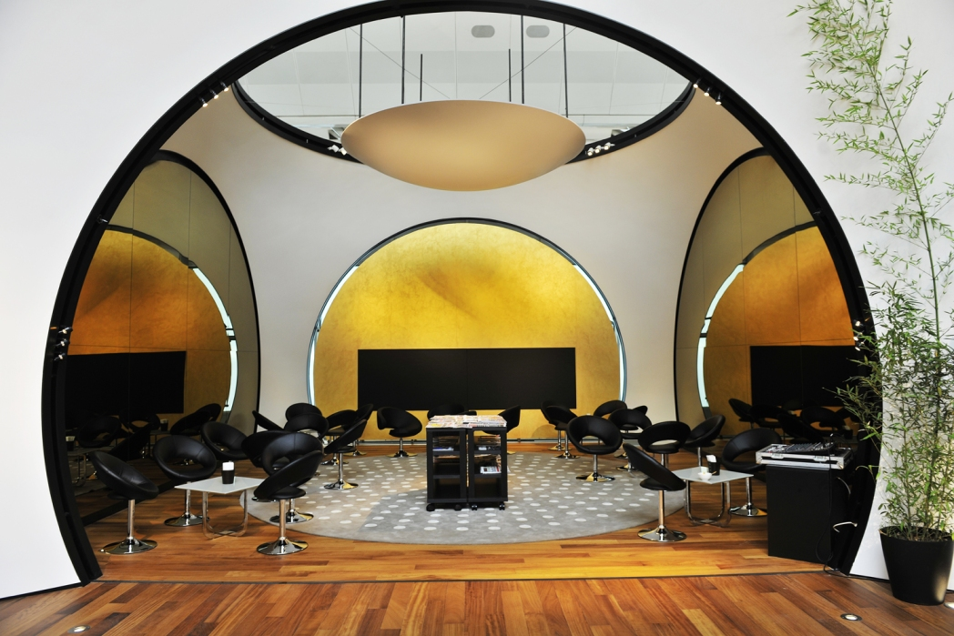 Comfortable seats in white retro domes of Turkish Airlines' CIP lounge
